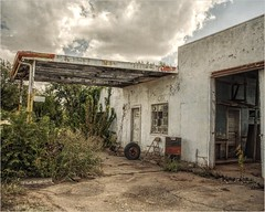 The Abandoned Garage (A Anderson Photography, over 2.1 million views) Tags: garage canon abandoned chair barrel tire overgrown