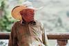 Old Cowboy Leaning on Rail, Angostura Colombia (AdamCohn) Tags: kmtoin adamcohn angostura colombia cowboy cowboyhat geo:lat=6885711 geo:lon=75335215 geotagged man portrait talking wwwadamcohncom antioquia