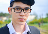 Portrait of Asian young man with glasses (phuong.sg@gmail.com) Tags: adults alone asian bright candid casual cheerful confidence confident contemporary content cool cropped ethnic ethnicity friendly guy hair handsome happiness happy horizontal individuality lens lifestyle looking male man men modern one outdoors people person portrait positive positivity real short sidewalk smile smiling space standing