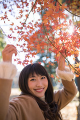 Young woman standing under autumn foliage (Apricot Cafe) Tags: img74041 asia asianandindianethnicities healthylifestyle japan japaneseethnicity sigma35mmf14dghsmart tokyojapan yoyogipark autumn autumnleafcolor backlit candid capitalcities carefree casualclothing charming cheerful colorimage enjoyment happiness holding leisureactivity lifestyles longhair lookingatcamera morning nature oneperson onlyjapanese outdoors people photography publicpark realpeople smiling straighthair student sunlight sustainablelifestyle toothysmile waistup women youngadult shibuyaku tōkyōto jp