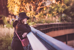 Thinking About ... (Irene SC) Tags: newyork high line people park sunset fall city autumn hat girl trees bokeh candid retrato portrait