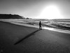 The lonely fisherman (Alberto Vanoli) Tags: shadows landscape nature people beaches men sunsetsunrise bw photo sports sea