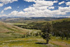Entering Lamar Valley_27A0456 (Alfred J. Lockwood Photography) Tags: alfredjlockwood nature landscape lamarvalley hills clouds grasses field forest mountains yellowstonenationalpark wyoming summer noon