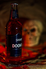 Doomed (Steve Purnell Photography) Tags: beer beverage bottle alcohol blood bloodstained skull sackcloth hessian stilllife macabre horror bones head flax hemp fabric texture moody death skeleton natural rustic linen jute pattern weave background textile grunge grungy teeth spooky dead grim life human jaw mouth dark deathskull humanskulls cranium disembodied doomed fate mystery