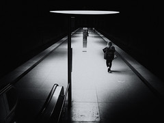 spotlight (Sandy...J) Tags: olympus atmosphere street streetphotography sw station subway urban underground walking walk light blackwhite bw black white darkness noir women monochrom city munich germany shadow silhouette