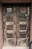 NOT ART - PRO (UrbanphotoZ) Tags: doorway doors wood wooden weathered worn peeling notart stencil pro graffiti wheel bicyclewheel chelsea manhattan newyorkcity newyork nyc ny