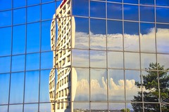 Reflecting the reflection - Reflétant le reflet (olivier_kassel) Tags: building reflet reflection clouds nuages ciel exoticimage poeexcellence wow