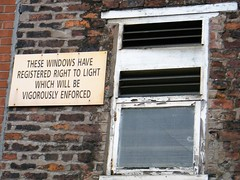 Manchester = right to light sign = see definition (rossendale2016) Tags: above vents windows security wired metro station stop tram facing wall up high glazed glass pane loose drafts fashioned old warning sign window legally legal enforced loght right