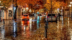 Rainy Autumn Night (Christie : Colour & Light Collection) Tags: street leaves autumn fall wet buildings vancouver gastown rain rainy shine reflections nikon orange night streetscene buidings downtown bc canada britishcolumbia autumnleaves