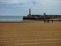 Beachcombing (Steve Taylor (Photography)) Tags: beachcombing pier lighthouse people men uk gb england greatbritain unitedkingdom margate beach sea ocean texture lowtide jetty lines