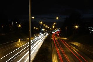 Light trails: Cars pass under Haukilahti overpass in Espoo, Finland
