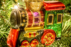 Polar Express (FotoFloridian) Tags: christmas holiday hannukah tree ornament train macro sony alpha a6000 greetings closeup red toy decoration cultures backgrounds shiny goldcolored celebration retrostyled oldfashioned