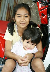 pretty young ladies (the foreign photographer - ฝรั่งถ่) Tags: two pretty young ladies seated motorcycle khlong thanon portraits bangkhen bangkok thailand canon