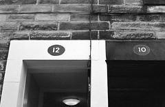 12 and 10 Sun Strreet Lancaster (Man with Red Eyes) Tags: number door 12 10 sunstreet leicam2 berggerpancro400 pyrocathd 11100 16mins 70f analog analogue blackwhite monochrome silverhalide sunnysixteen filmtest homedeveloped v850 lancaster lancashire northwest