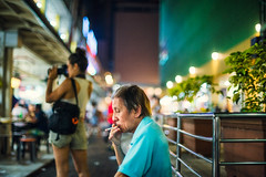 By The Bustle Diners (Jon Siegel) Tags: nikon nikkor d810 50mm 12 nikon50mmf12 man smoking elderly thoughtful patient tired busy night evening chinese chinatown singapore singaporean street candid people smoke cigarette