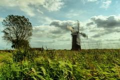 Blowin In The Wind (jakeof) Tags: windmill wind norfolkbroads davidjacobs england clouds tree longexposure
