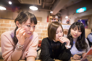 Female friends looking at menu in restaurant