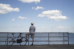 Bicyclist by the Lake (Sean Anderson Media) Tags: pinhole pinholelens pinholephotography lofi lofiphotography homemadelens faded lakemichigan lakeside chicago sonya7s city downtown bicyclist bodycappinhole water horizon summer guardrail sky clouds bluesky blurry outoffocus bikepath waterside lake lonefigure bicycle vintage retro