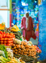 At The Vegtable Market (TablinumCarlson) Tags: medina market markt lebensmittel food afrika africa marokko morocco tanger tür door altstadt city old town leica m m240 summicron tangier طنجة tandscha tanga maghreb strait gibraltar maroc dof bokeh 90mm northern available light lady woman oldwoman blue blau bananen banane banana tomato tomate kartoffel gemüse vegetable vegetablemarket gemüsemarkt souk souq
