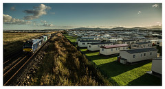 Nuclear dawn in Caravan City (david.hayes77) Tags: towyn towynbeach northwales wales coast 6d43 nuclearflasks 2017 caravanpark sandbankroad drs directrailservices cat class68 68029 68018 destroyer vigilant conwy caravans sidelight autumn vossloh