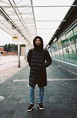 Marat waiting for a bus on a station. Helsinki, November 17 (arsenterzyan) Tags: busstation arsent portra160 kodak grain film eos3 canon finland autumn travel helsinki 1635 portrait man