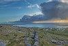 Storm arriving with the sunrise.. (Derek O'Bryan) Tags: galway galwaybay clare ireland inismor island west westcoast storm squall cloud cell thunder lightening rain showers wet mist sea green blue waves pier wall wild atlantic way wildatlanticway grass houses buttercups flowers fauna sun