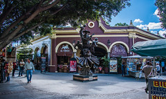 2017 - Mexico - Tlaquepaque -  Believe in my Roots (Ted's photos - Returns Late December) Tags: 2017 cropped guadalajara mexico nikon nikond750 nikonfx tedmcgrath tedsphotos tedsphotosmexico vignetting guadalajaramexico guadalajarajalisco tlaquepaque elparián tlaquepaqueelparián elpariándetlaquepaque sculpture bronzesculpture streetscene street people peopleandpaths mariachis denim denimjeans arches columns paco's