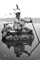 India - New Delhi (luca marella) Tags: india newdelhi yamuna river blackwhite bw bn biancoenero lucamarella water man reportage documentary people asia raft reflection mirror boat