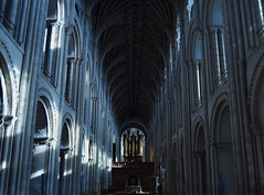 Norwich Cathedral Foreboding (joelpwilliams) Tags: christianity cathedral christian church interior building architecture britain england uk organ arches nikon ornaments ornate statues woods christ ceiling perspective blue ominous foreboding devotion room stone marble europe bestofflickr bestofphotoshop travelphotography travel city culture imposing pillars structure still spire norwich composition converging colours