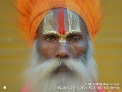 2017-03a Gujarat (18b) (Matt Hahnewald) Tags: facingtheworld character head face forehead urdhvapundra eyes beard fullbeard turban consent rapport emotion respect dignity religious spiritual traditional cultural hinduism sadhu guru baba devotee worshiper pilgrim dwarka gujarat asian indian male adult elderly man picture photo faceperception physiognomy primelens 4x3 horizontal street portrait closeup orange outdoor color editing posing authentic filter focalzoom matthahnewaldphotography nikond3100 painted picasa travel vaishnavism vaishnavite westernindia 50mm oneperson postprocessing fullfaceview expression headshot nikkorafs50mmf18g lookingcamera