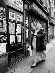 Northern Quarter 170 (Peter.Bartlett) Tags: manchester bag niksilverefex unitedkingdom woman people walking city graffiti urbanarte noiretblanc peterbartlett door streetphotography lunaphoto shutter urban poster monochrome uk m43 microfourthirds olympuspenf bw eyecontact sign blackandwhite candid doorway england gb