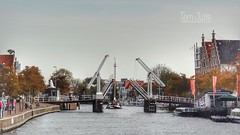 Gravestenenbrug, Binnen Spaarne, Haarlem, Netherlands - 5593 (HereIsTom) Tags: webshots travel europe netherlands holland dutch view nederland views you sony cybershot hx9v nature sun tourists cycle vakantie fietsvakantie cycling holiday bike bicycle fietsen centre rivier 21 canal brug city 1863 2017 town water noord spaarne binnen ophaalbrug bridge 1950 september centrum stad urban gravestenenbrug haarlem village boot schip zeilschip vessel ship buildings boats