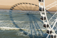 Big wheel and shadow (Jan van der Wolf) Tags: map1748vv people bigwheel reuzenrad beach strand scheveningen shadow shadows shadowplay schaduw schaduwspel wave waves golven branding surf sea zee sand zand