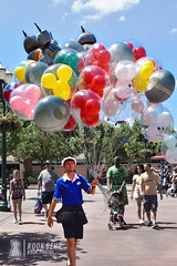 Balloon Seller at Hollywood Studios (rook.behr) Tags: balloons crowd street people outdoorscenescape groups hollywoodstudios hat man disneyworld tree outdoors bydescription nostalgic day castmember plaza outside scenedesign scenery setdesign setting