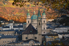 Franciscan church and Salzburg cathedral on a day in late autumn (echumachenco) Tags: autumn autumncolors fall november tree forest leaf twig foliage hillside grass house city history art baroque medieval cityscape church spire steeple cathedral dom franziskanerkirche glockenspielturm carillon stiftnonnberg architecture salzburg austria österreich mönchsberg nikond3100 building tower
