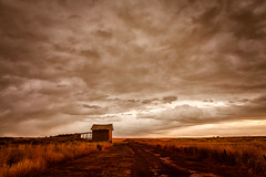 From Another Time (KPortin) Tags: abandoned abandonedbuilding sky sunset stormy lincolncounty clouds grass fields landscape