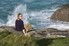 Splash! (Mister Oy) Tags: davegreen oyphotos ©oyphotos cornwall stives sarah daughter waves cliffs swa shore coast fujixpro2 fuji50140mmf28 girl sitting