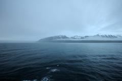 Eyjafjörður II (Frau Koriander) Tags: iceland island landscape landschaft nordic akureyri fjord mscpreziosa nikond300s sigma1020mm meer ocean sea water wasser eyjafjörður fog foggy nebel neblig snow schnee berge mountains seascape arctic summeriniceland
