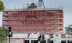 Green Light For Development (M C Smith) Tags: walthamstow dogtrack building construction netting green signs trees scaffolding net blue trafficlights red crane clock flags poster white letters symbol dog black