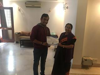 Blue Pen Volunteer Jai Khatri receiving internship completion certificate from Dr Manorama Khanna,Chairman Blue Pen