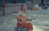 Street musician (aris paizanos-mavrakis) Tags: greece greek musician lavta athens analog ektar kodakektar100 100asa olympus om1 zuiko 135mm street streetphotography film portait woman slr