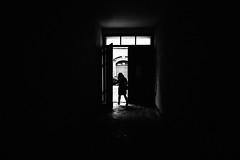 Emerge 83.365 (ewitsoe) Tags: monochrome bnw blackandwhite ewitsoe dark sjadows light door doorway open lady woman poznan poland jezyce 365 sigmaart20mm leaving street city urban darkness