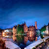 Blue Hour In Bruges (Alec Lux) Tags: architecture autumn belgium bluehour branches bruges brugge building buildings canal city colorful colors daylight fall landscape longexposure medieval nature old season street sunlight sunset tree water vlaanderen be