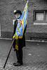 The Flag Bearer (IAN GARDNER PHOTOGRAPHY) Tags: suit maninasuit bowlerhat colourpop portrait streetportratstreetstreetphotographyarmisticedaybedworthflagbannerstandardstandardbearer glasses spectacles monochrome