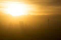 Las Vegas (FreezeTimeDigital) Tags: lasvegas vegas sincity sunset thestrip skyline skyscrapers mountains hotel resort casino sun valley nevada orange gold goldenshower