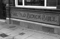The Old Black Bull Preston (Man with Red Eyes) Tags: pub preston lancashire northwest nikonf6 50mmf18ai berggerpancro400 divided d76h 5minsa5minsb v850 analog analogue blackwhite monochrome silverhalide street filmtest
