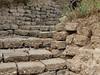 stones (boxerrod) Tags: soil houston stones steps rocks leaves brown walking up drain pipes wall