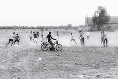 Sahara soccer (Sebastian Sighell) Tags: blackwhite monochrome streetphotography rural travel morocco sahara desert soccer football sony people sand bike