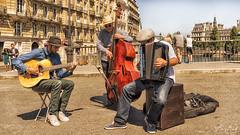 Trio on Pont St Louis (BAN - photography) Tags: musicians guitarist accordionist bassist doublebass guitar accordion bridge d810 paris ilesaintlouis pontsaintlouis riverseine buildings balconies tourists