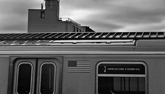 Express to Nowhere (Robert S. Photography) Tags: subway train sign bw monochrome building man construction roof sky clouds express brighton brooklyn nyc sony dscwx150 iso100 november 2017